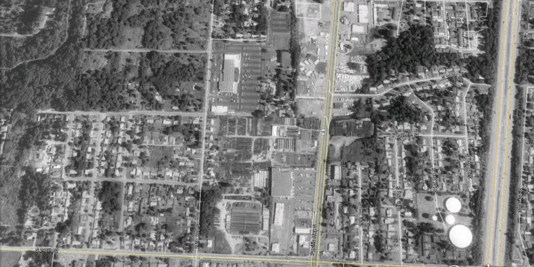 Aerial photograph of residential neighborhoods on DMCBP site in1990.